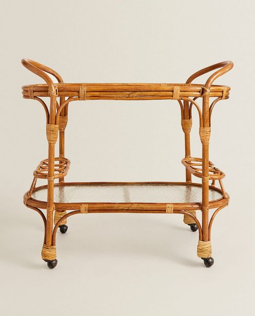 Rattan And Hammered Glass Trolley offers at 1699 Dhs